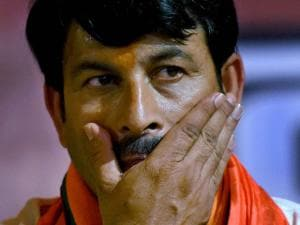 Delhi BJP President and MP Manoj Tiwari gestures during a press conference