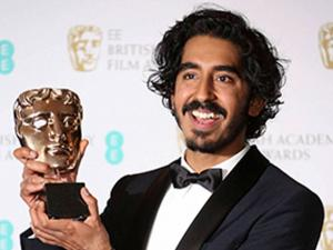 Dev Patel poses for photographers with his BAFTA award