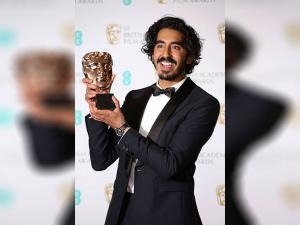 Dev Patel poses for photographers with his BAFTA award for Best Supporting Actor for his role in the film 'Lion'