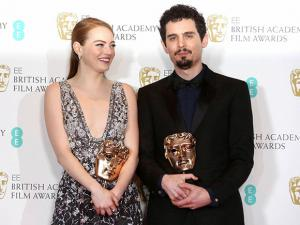Emma Stone with her BAFTA award for Best Actress and director Damien Chazelle with his BAFTA award for Best Director both for the film La La Land'