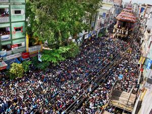 Devotees pulling the temple car as a part of the Chithirai festival of Meenakshi Amman Temple in Madurai