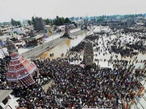 Devotees take part in the Chariot procession of Lord Shiva near the Kumbakonam Mahamaham pond on the occasion of the Mahamaham festival 2016 in Kumbakonam