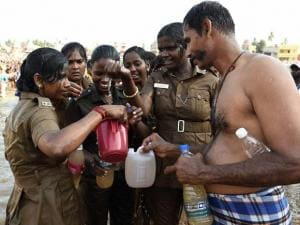 Police personnel after taking holy bath at the Kumbakonam Mahamaham pond on the occasion of the Mahamaham festival, at Kumbakonam in Thanjavur district