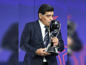Argentina's former soccer player Diego Maradona kisses the FIFA U-20 World Cup trophy
