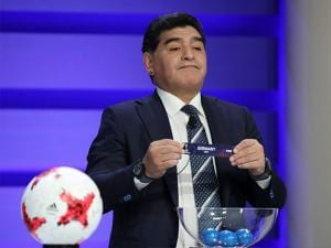 Diego Maradona holds up the name of Germany during the official draw for the FIFA U-20 World Cup Korea 2017