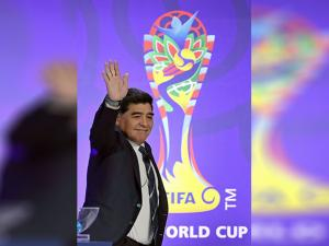 Diego Maradona waves upon his arrival for the official draw for the FIFA U-20 World Cup Korea 2017