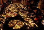 Devotees light lamps in Keshev Dev Temple premises