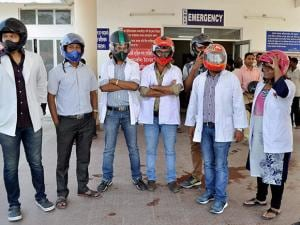 Junior doctors of Guwahati Medical College Hospital (GMCH), wearing helmets, staging a demonstration in Guwahati