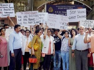 Resident doctors along with senior doctors take out a protest rally at the KEM hospital