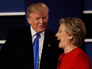 Republican Donald Trump shakes hands with Democratic  Hillary Clinton