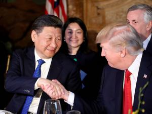 President Donald Trump and Chinese President Xi Jinping shake hands during a dinner at Mar-a-Lago