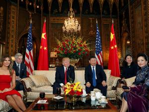 President Donald Trump and Chinese President Xi Jinping, sit with their wives, first lady Melania Trump and Chinese first lady Peng Liyuan