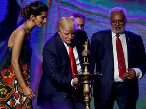 Republican presidential candidate Donald Trump lights a diya before delivering remarks to the Republican Hindu Coalition