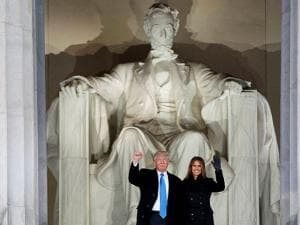 President-elect Donald Trump, left, and his wife Melania Trump arrive to the Make America Great Again Welcome Concert at the Lincoln Memorial