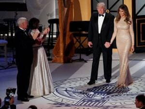 Vice President-elect Mike Pence, left, and his wife Karen, second from left, applaud as President-elect Donald Trump and his wife Melania arrive for a VIP reception and dinner with donors