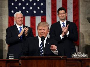 President Donald Trump gestures on Capitol Hill in Washington