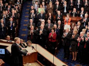 Republicans lawmakers applaud as President Donald Trump speaks to a joint session of Congress