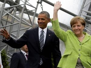 Former U.S. President Barack Obama  and German Chancellor Angela Merkel