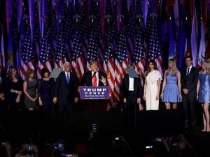 Donald Trump gives his acceptance speech during his election night rally as he is surrounded by his family and Vice-President-elect Mike Pence and his family