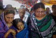 Grieving relatives and other people at former President APJ Abdul Kalam's house
