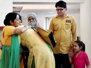 External Affairs Minister Sushma Swaraj  greeting Indian woman Uzma as her family members look on