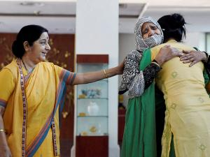 Sushma Swaraj consoling the mother-duo at Jawahar Bhawan after after Indian woman Uzma reached Delhi