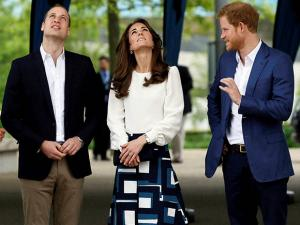 Britain's Prince William, left, and Kate, the Duke and Duchess of Cambridge and Prince Harry look up as they arrive to attend the launch of Heads Together, their ambitious new campaign to end stigma on
