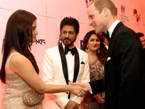 Prince William, Duke of Cambridge shakes hands with actress Aishwarya Rai Bachchan as Madhuri Dikshit and Shahrukh Khan look on during the Bollywood theme dinner in Mumbai.