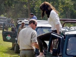Catherine (Kate), Duchess of Cambridge jumps from a jeep during Safari ride inside the Kaziranga National Park of Assam, on Wednesday. Also seen in the picture is  Prince William_01