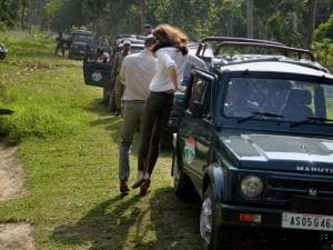 Catherine (Kate), Duchess of Cambridge jumps from a jeep during Safari ride inside the Kaziranga National Park of Assam, on Wednesday. Also seen in the picture is  Prince William_03
