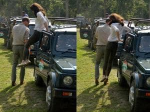 Combo- Prince William, Duke of Cambridge and his wife Catherine (Kate), Duchess of Cambridge jumps from a jeep during Safari ride inside the Kaziranga National Park of Assam_02