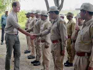 Prince William, Duke of Cambridge intracts with forest officials at Bimoli camp inside the Kaziranga National Park of Assam