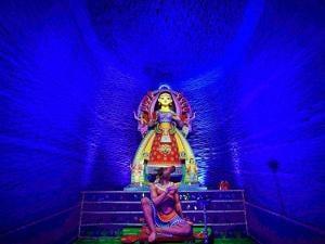 Devi Durga idol at a community puja pandal in Kolkata