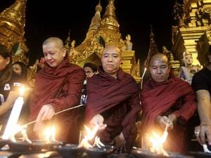 Buddhist monks light oil lamps during earth hour celebrations at Myanmar's famous Shwedagon pagoda