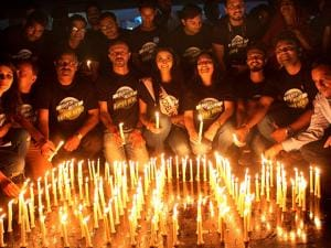 World Wildlife Fund (WWF) activists light candles to observe Earth Hour in Bhopal