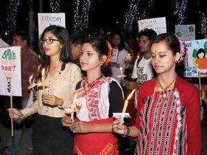 Youths march with candles in support of Earth Hour organised by WWF-India Global Campaign throughout the country, in the Dighalipukhuri Park, Guwahati