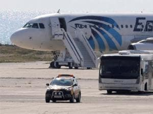 A bus carrying some passengers from the hijacked EgyptAir aircraft as at it landed at Larnaca airport