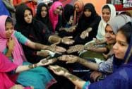 Girls show Mehndi designs on their hands  ahead of Eid-ul-Fitr in Kozhikode