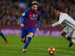 Lionel Messi runs with the ball during the Spanish La Liga soccer match