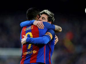 Luis Suarez  celebrates with teammate Lionel Messi
