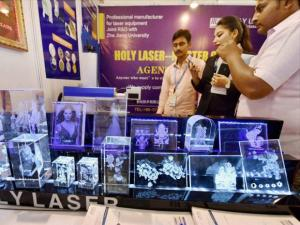 Visitors at a stall during the Laser World of Photonics and Electronica India 2015 exhibition