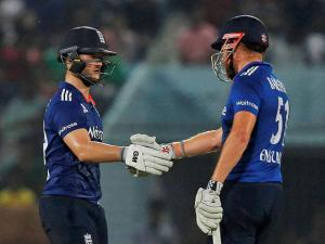 Jonny Bairstow congratulates teammate Ben Duckett for scoring fifty runs