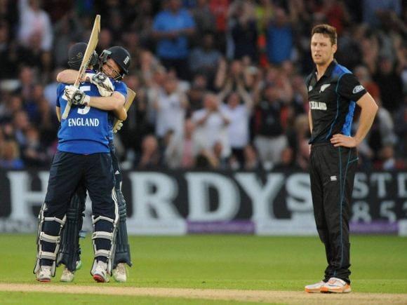 England's Eoin Morgan, celebrates a century with Joe Root, England, New Zealand, Cricket, 4th ODI, One Day International, Trent Bridge Cricket Ground, Nottingham