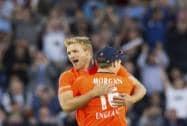 David Willey celebrates with captain Eoin Morgan