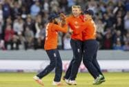 David Willey celebrates with captain Eoin Morgan and Adil Rashid