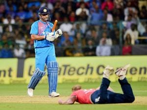 India's M S Dhoni watches as England's Ben Stokes falls on the ground during the 3rd T20 match
