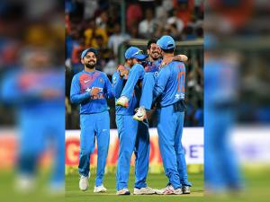 Yezuvendra Chahal with team mates celebrate the wicket of Ben Stokes during the 3rd T20 between India and England