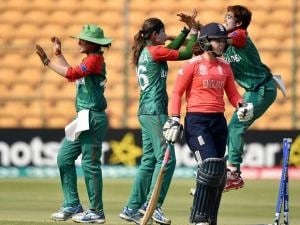 Bangladesh Woman Cricketer Jahanara Alam with team mates celebrate the wicket of  Tamsin Beaumont during the ICC Woman's World T20 match against England at Chinnaswamy Stadium