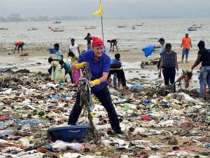 Erik Solheim Head of Environment, United Nations during a cleanliness drive at Versova Beach in Mumbai
