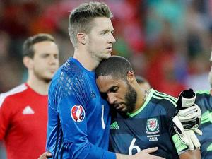 goalkeeper Wayne Hennessey consoles Ashley Williams at the end at Euro 2016